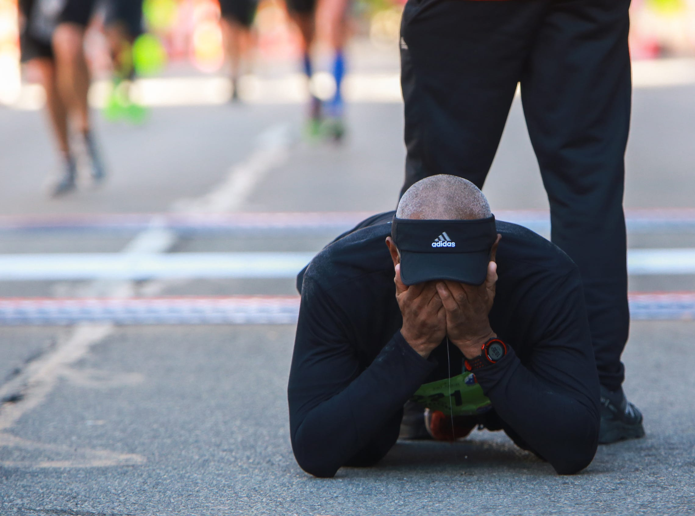 Lyndon Marsalis of Westland, gets emotional after crossing the finish line in downtown Detroit during his first full marathon during the 38th Annual Detroit Free Press/Talmer Bank Marathon on Sunday, Oct. 18, 2015.