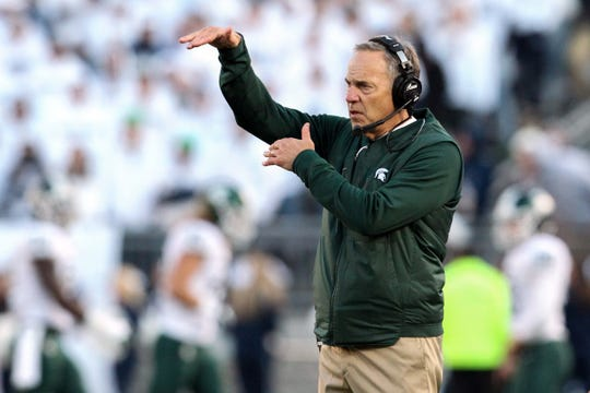 Mark Dantonio signals from the sideline during the third quarter against Penn State.