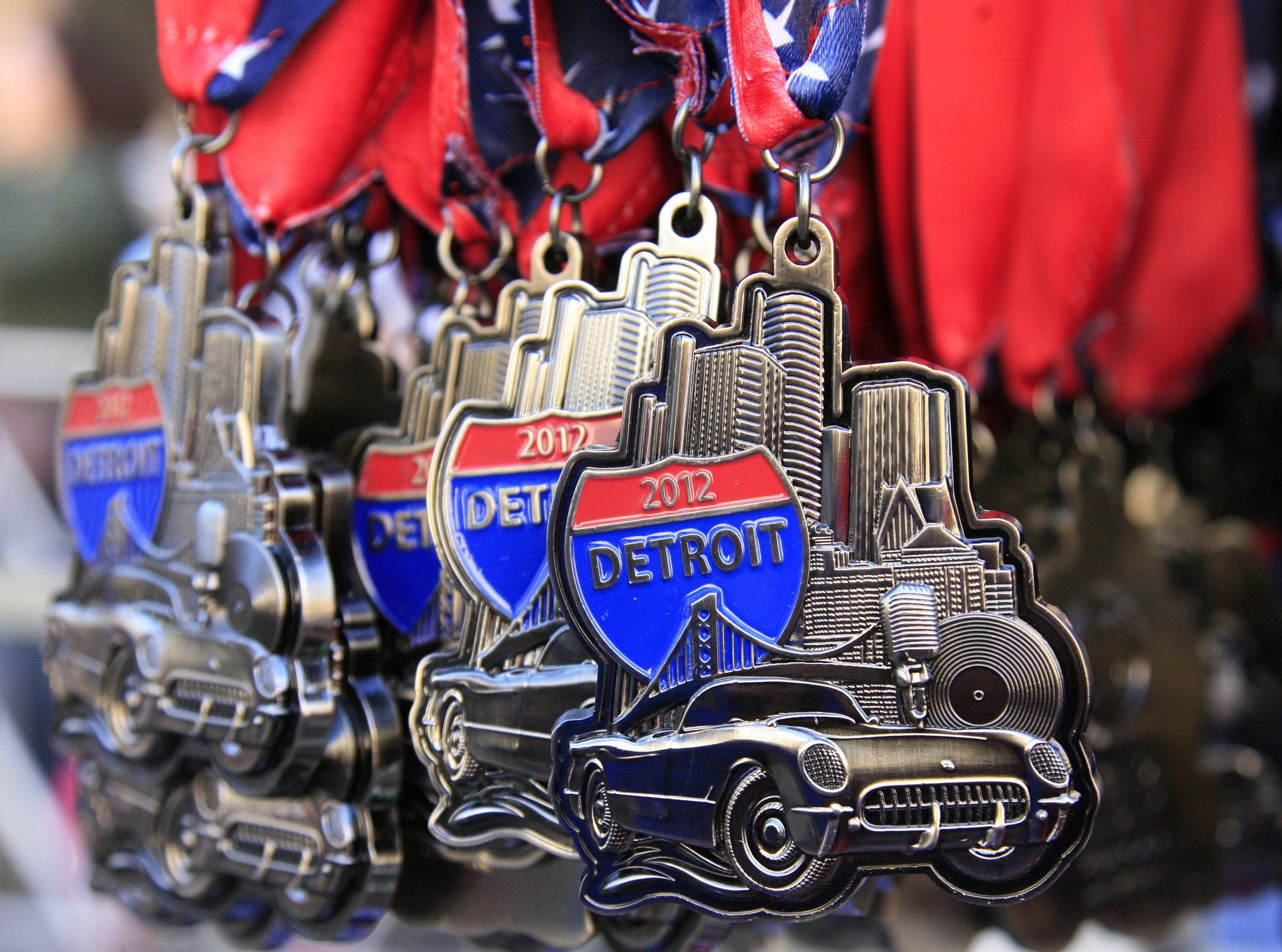Marathon medals hang at the Detroit Free Press/Talmer Bank Marathon in Detroit, Sunday, Oct. 21, 2012.