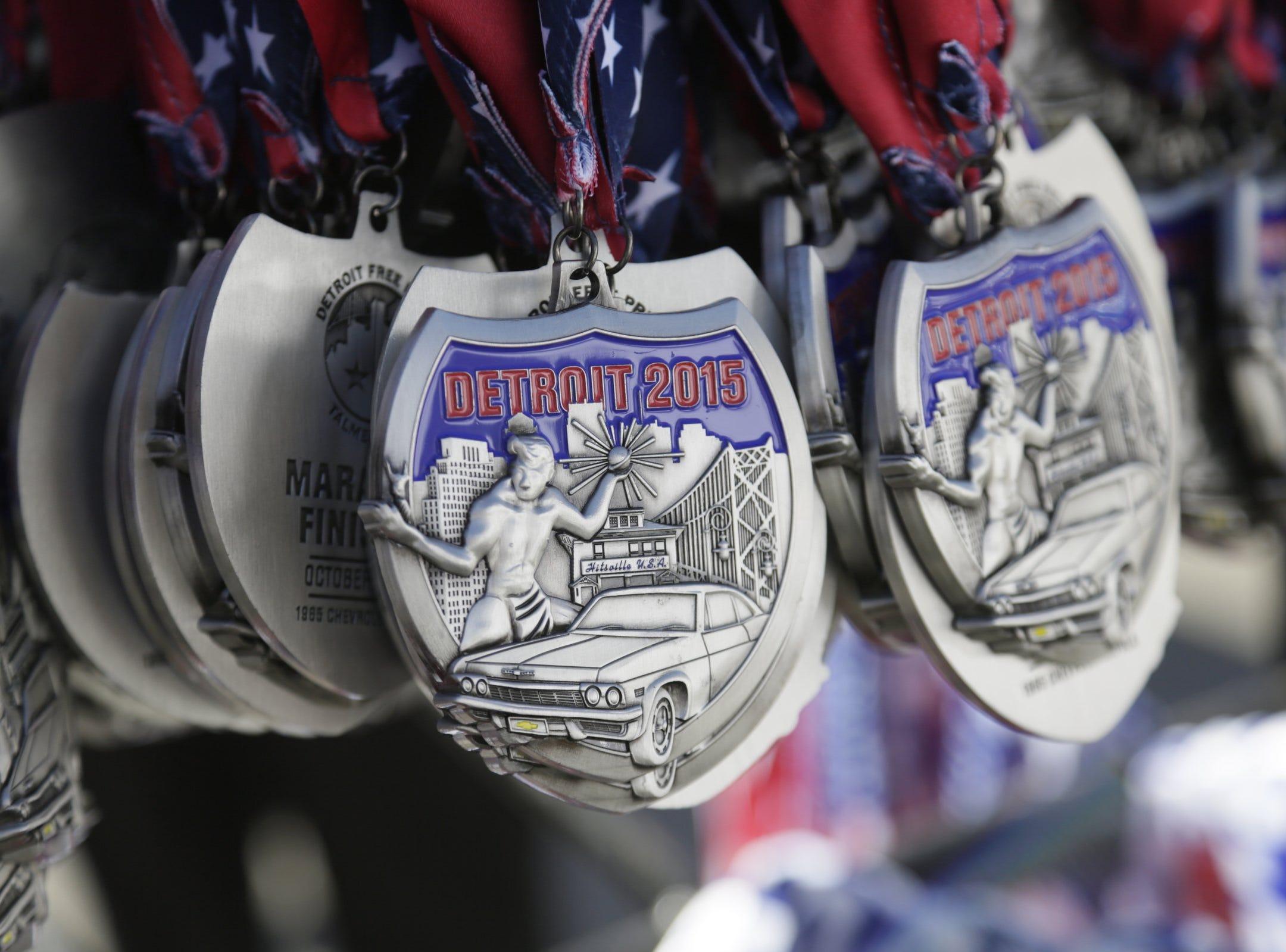 Marathon medals hang at the 38th Detroit Free Press/Talmer Bank Marathon Sunday Oct. 18, 2015.