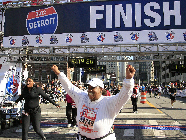 Kimberley Fisher, of Dearborn Heights finishes the half marathon at the Detroit Free Press/Talmer Bank Marathon in Detroit, Sunday, Oct. 21, 2012.