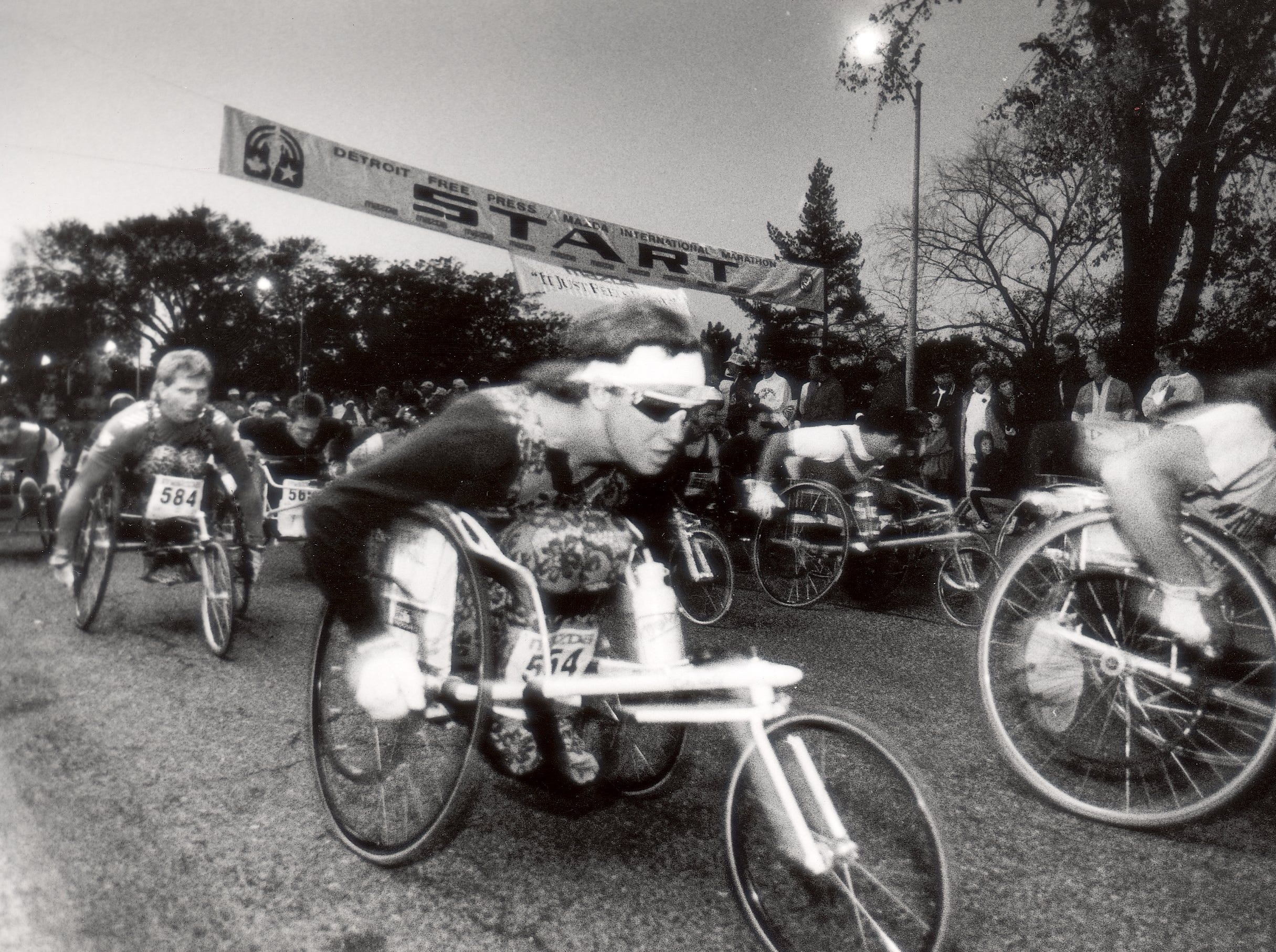 The start of the wheelchair and race walkers portion of the Free Press Marathon. They started 30 minutes before the other racers in 1990.