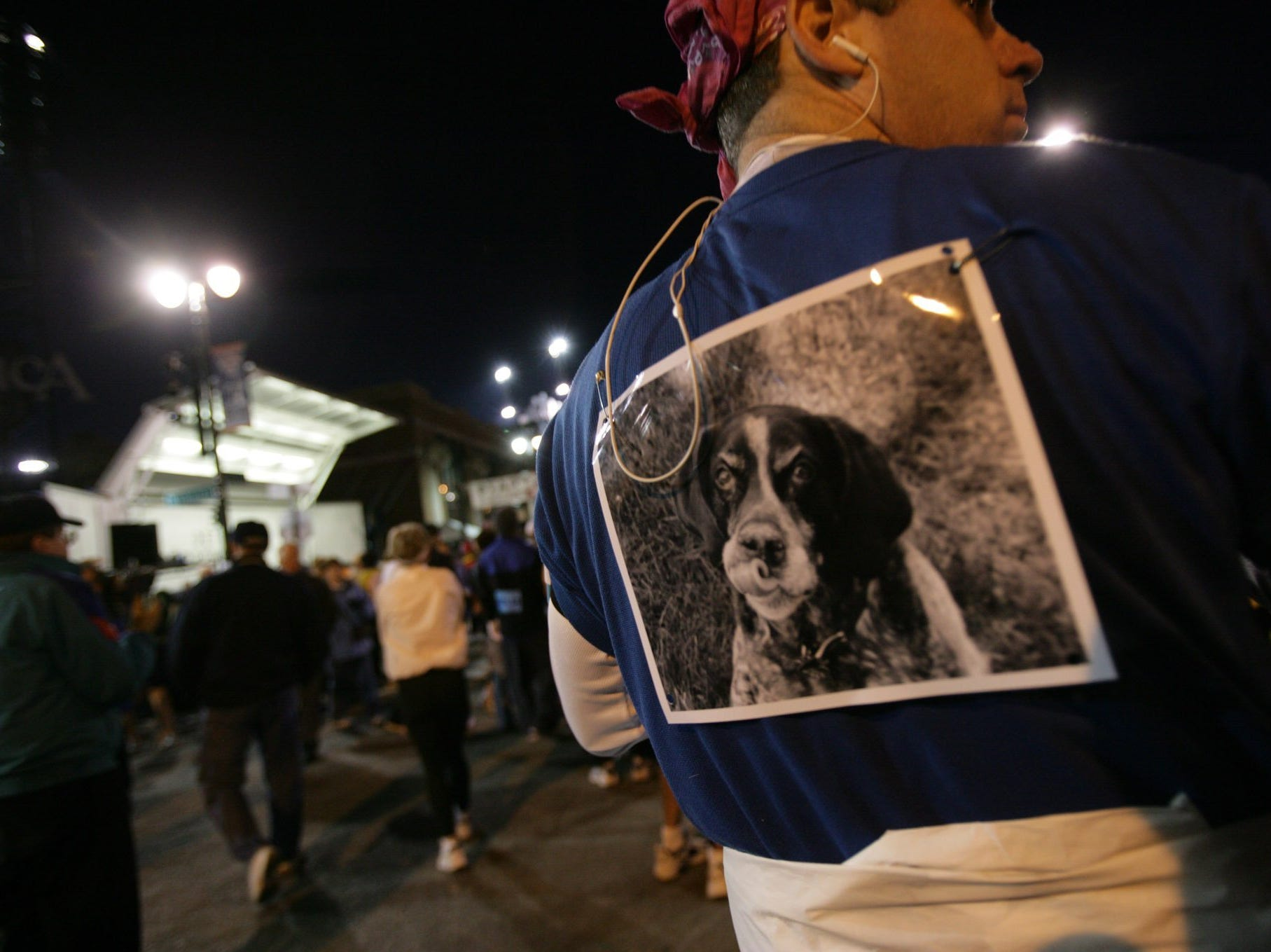 Pat McGlinn, 38, of Berkley, honors his dog Bridget who passed away, by wearing a photo of her during the 28th annual Detroit Free Press/Flagstar Marathon, Sunday, Oct. 23, 2005.