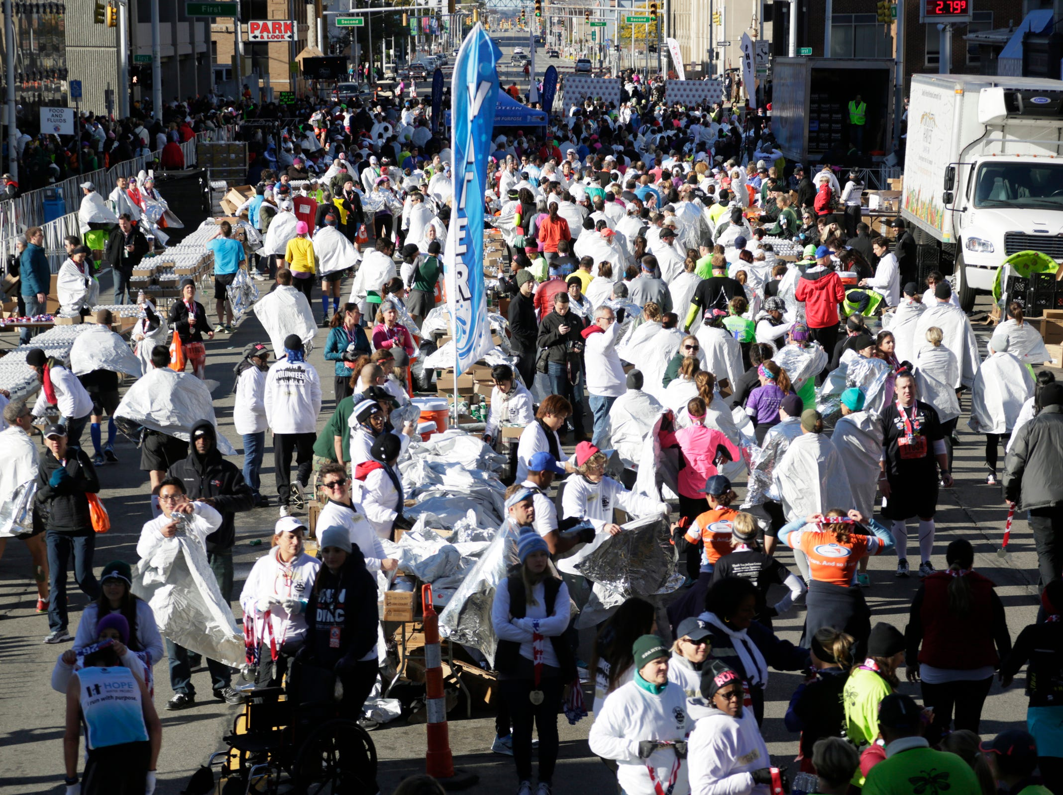 Throngs of racers get their medals from volunteers at the 38th Detroit Free Press/Talmer Bank Marathon Sunday Oct. 18, 2015.