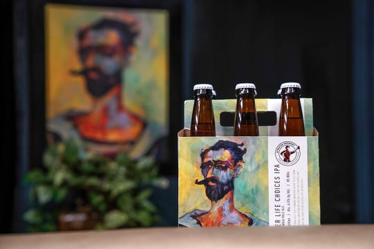 "A painting entitled ""Acey Ducey"" by Artist Tony Roko is was used by Atwater Brewery on the packaging of a six pack of beer at his studio in Plymouth on Friday, October 12, 2018."