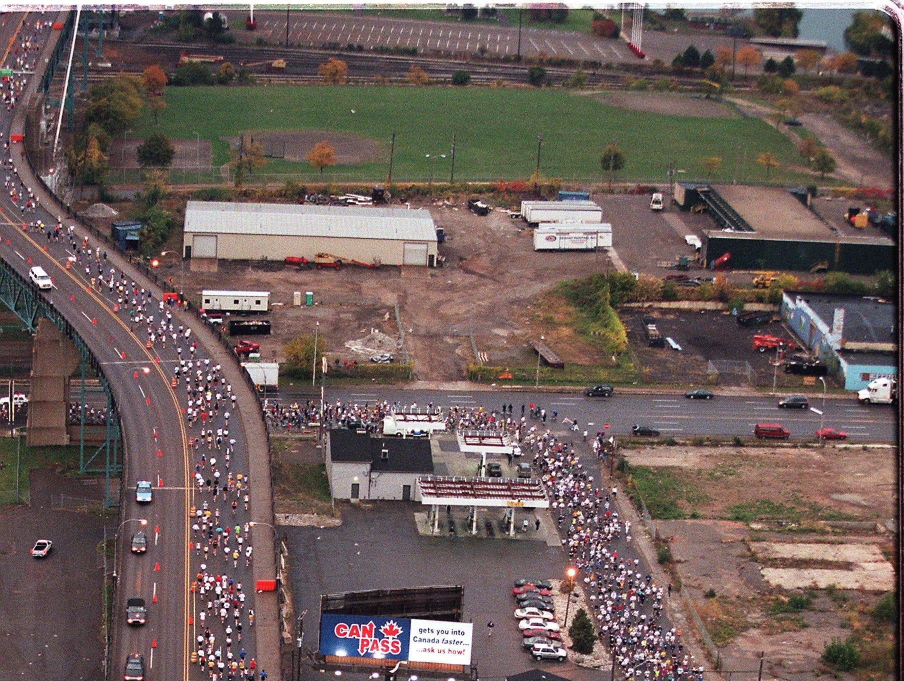 Runners make their way under, then across the Ambassador Bridge during The Detroit Free Press/Flagstar Bank International Marathon Sunday, Oct. 17, 1999, in Detroit.