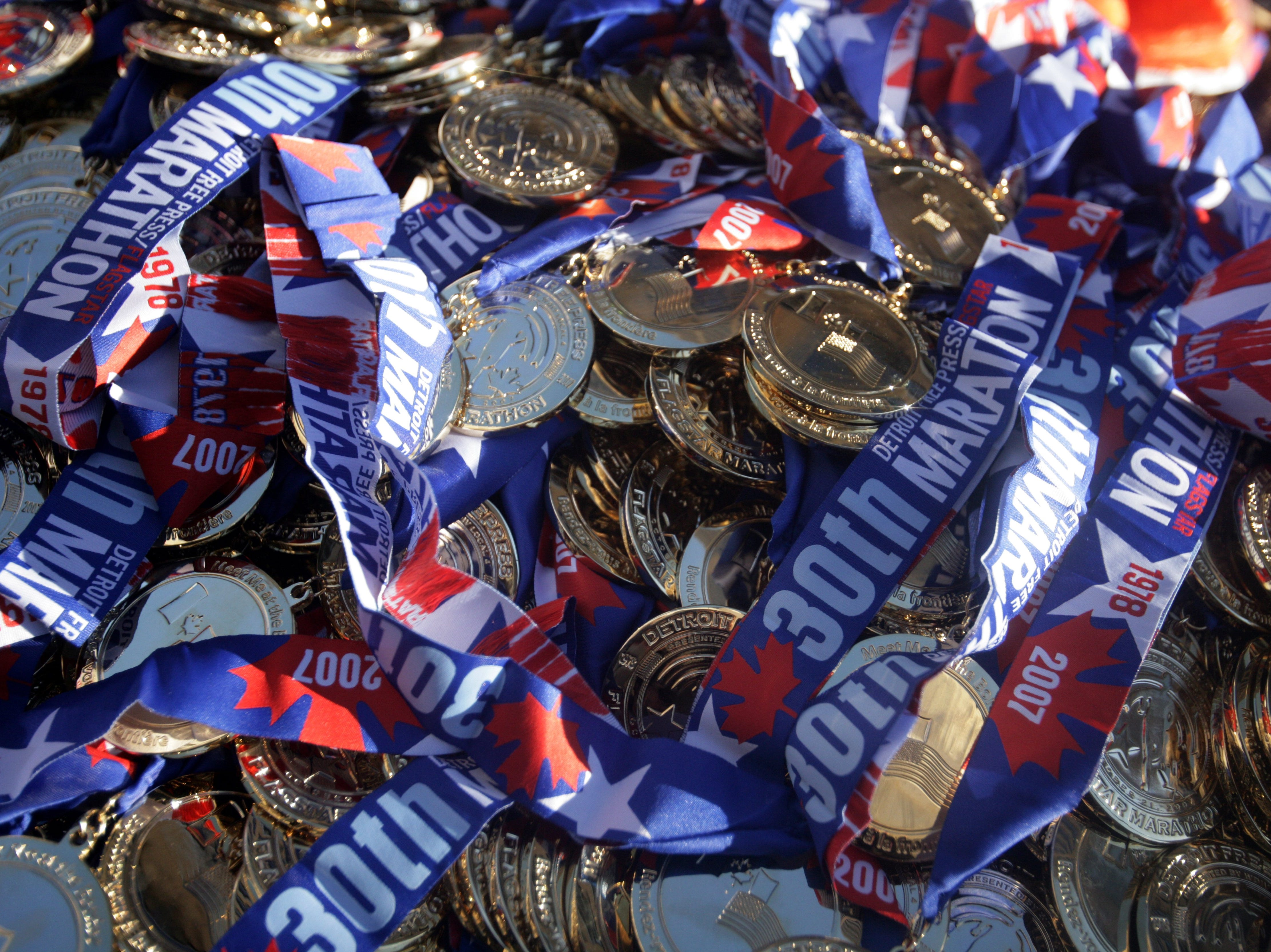 The medals that runners receive after crossing the finish line of the 30th Annual Detroit Free Press/ Flagstar Marathon in downtown Detroit Sunday, Oct. 21, 2007.
