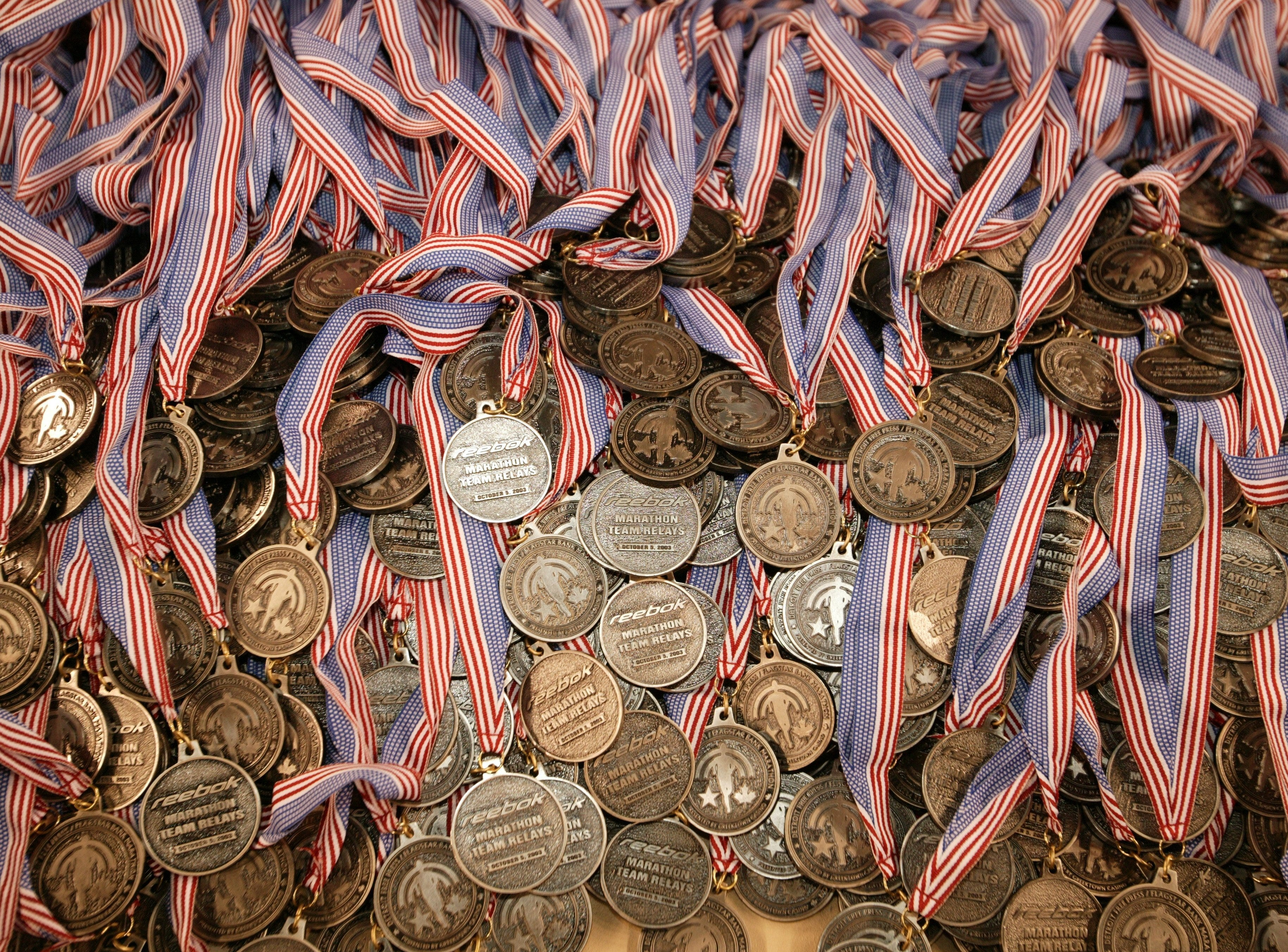 26th Annual Detroit Free Press/Flagstar Bank Marathon.Caption: Medals sit on a table inside Ford Field waiting for runners to finnish the 26th Annual Detroit Free Press / Flagstar Bank Marathon on Sunday October 5, 2003.