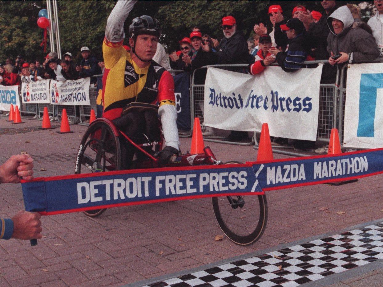 Man's wheelchair winner crossing the finish line in 1996.