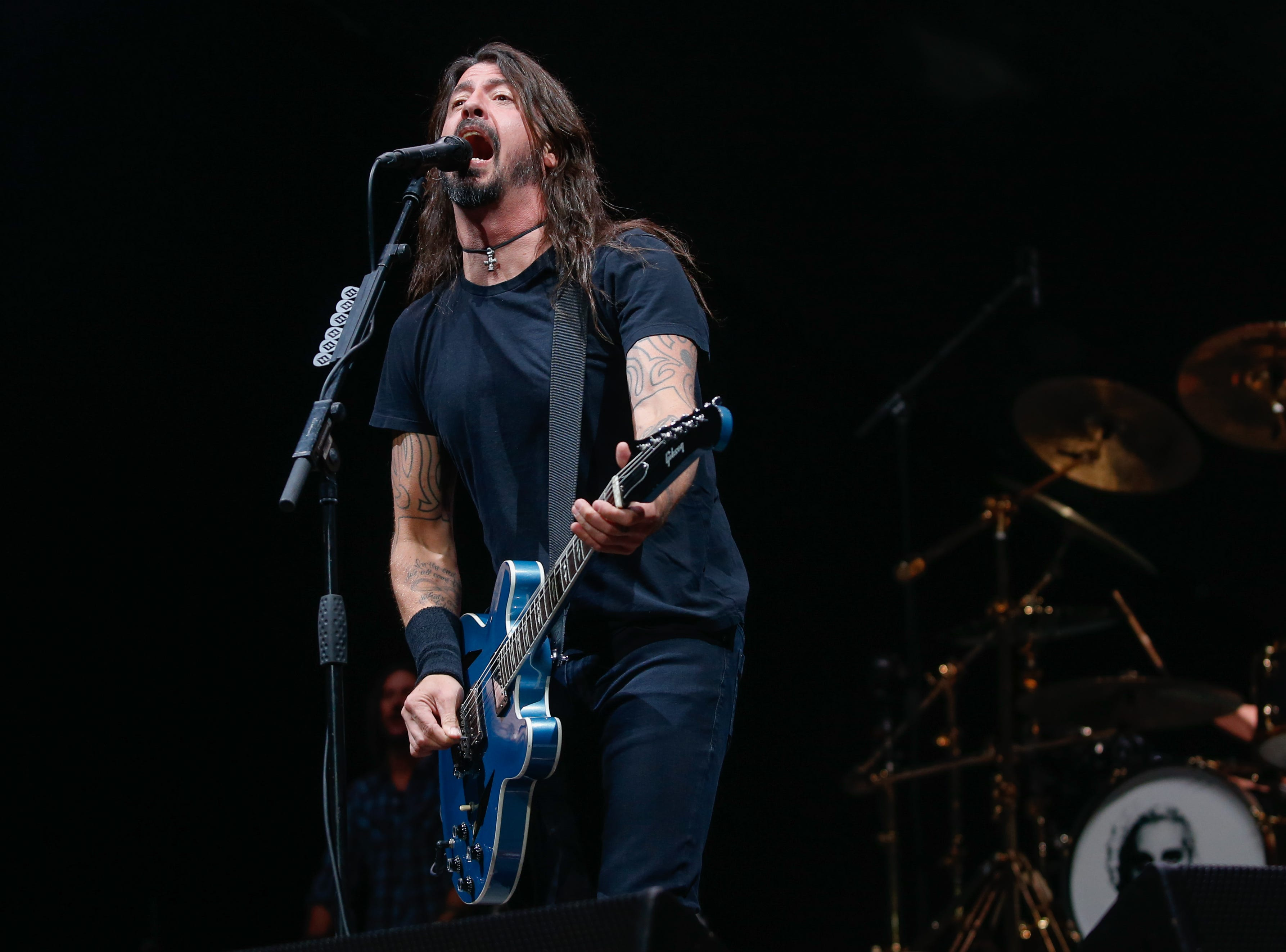 """Frontman Dave Grohl performs """"Run"""" from the Foo Fighters' current release """"Concrete and Gold"""" at Little Caesars Arena Monday."""