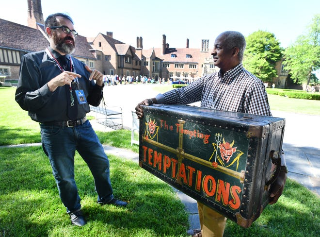 """Appraiser Gary Piattoni talks with Eric of Wayne County with a foot locker believed to be owned by the Temptations during filming for the """"Antiques Roadshow"""" on the grounds of Meadowbrook Hall. Filming for the """"Antiques Roadshow"""" comes to the grounds of Meadow Brook Hall, in Rochester, Michigan on June 14, 2018."""