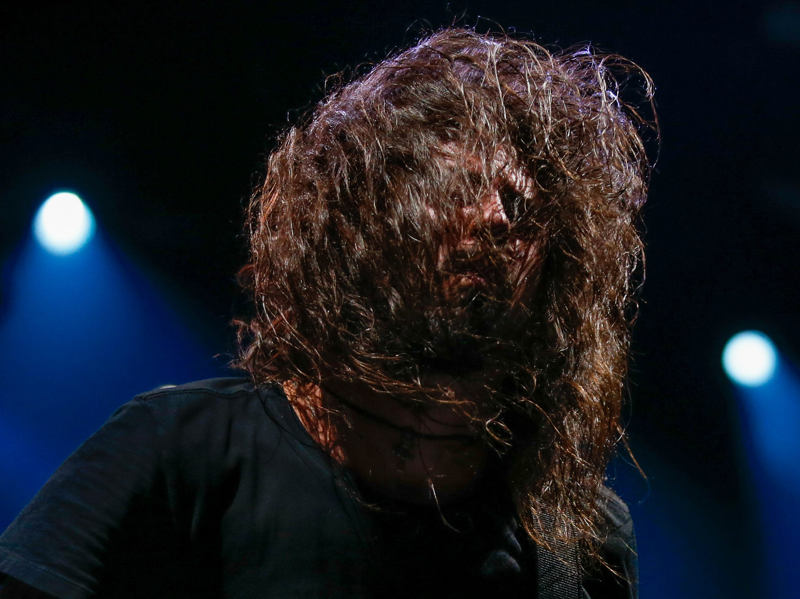 Yet another shot of Dave Grohl looking like a yeti as he flips his hair during the Foo Fighters' performance at Little Caesars Arena Monday.