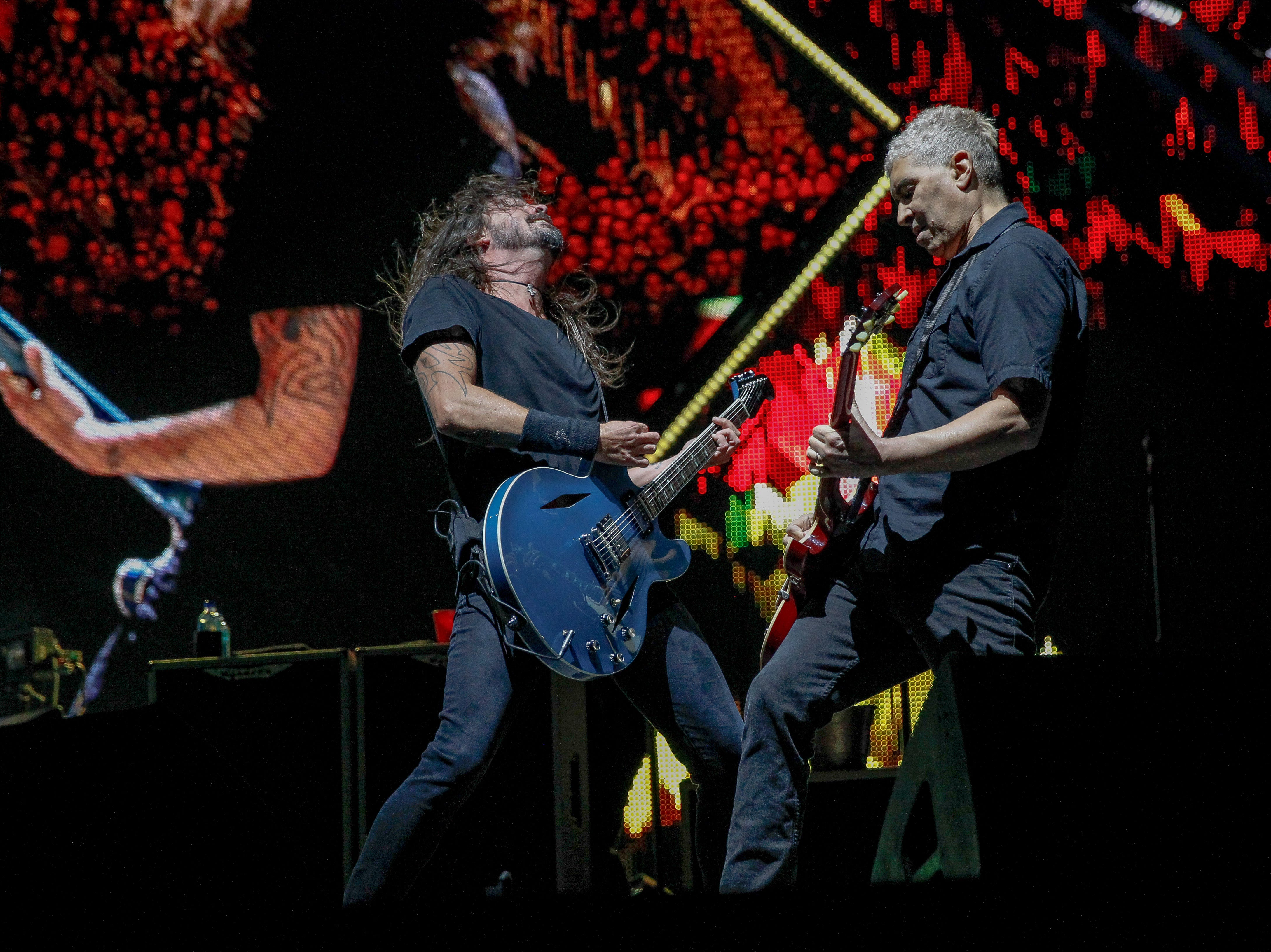Dave Grohl and Pat Smear jam together during Monday's Foo Fighters show at Little Caesars Arena.