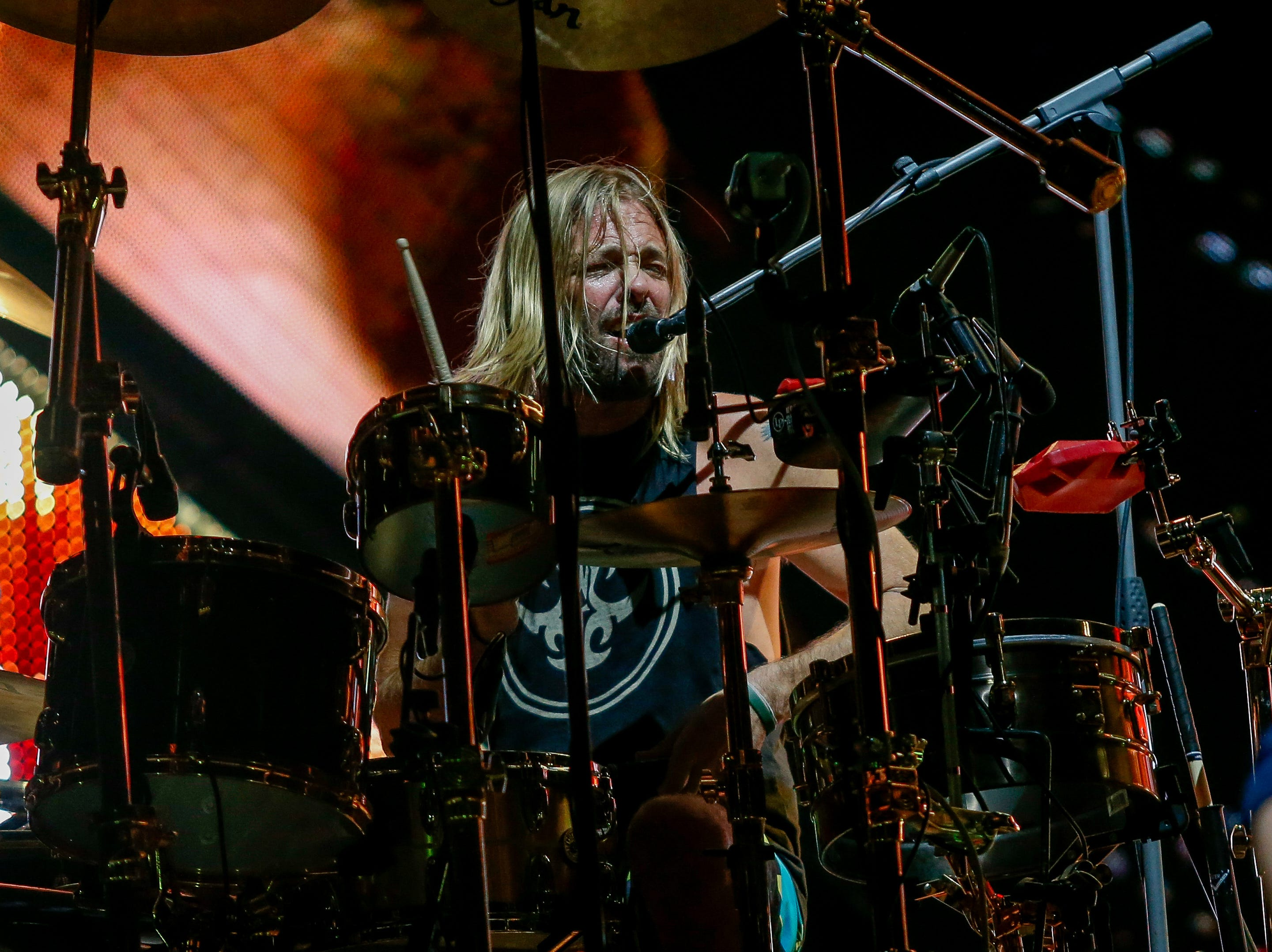 Drummer Taylor Hawkins adds backing vocals during Monday's concert at Little Caesars Arena.