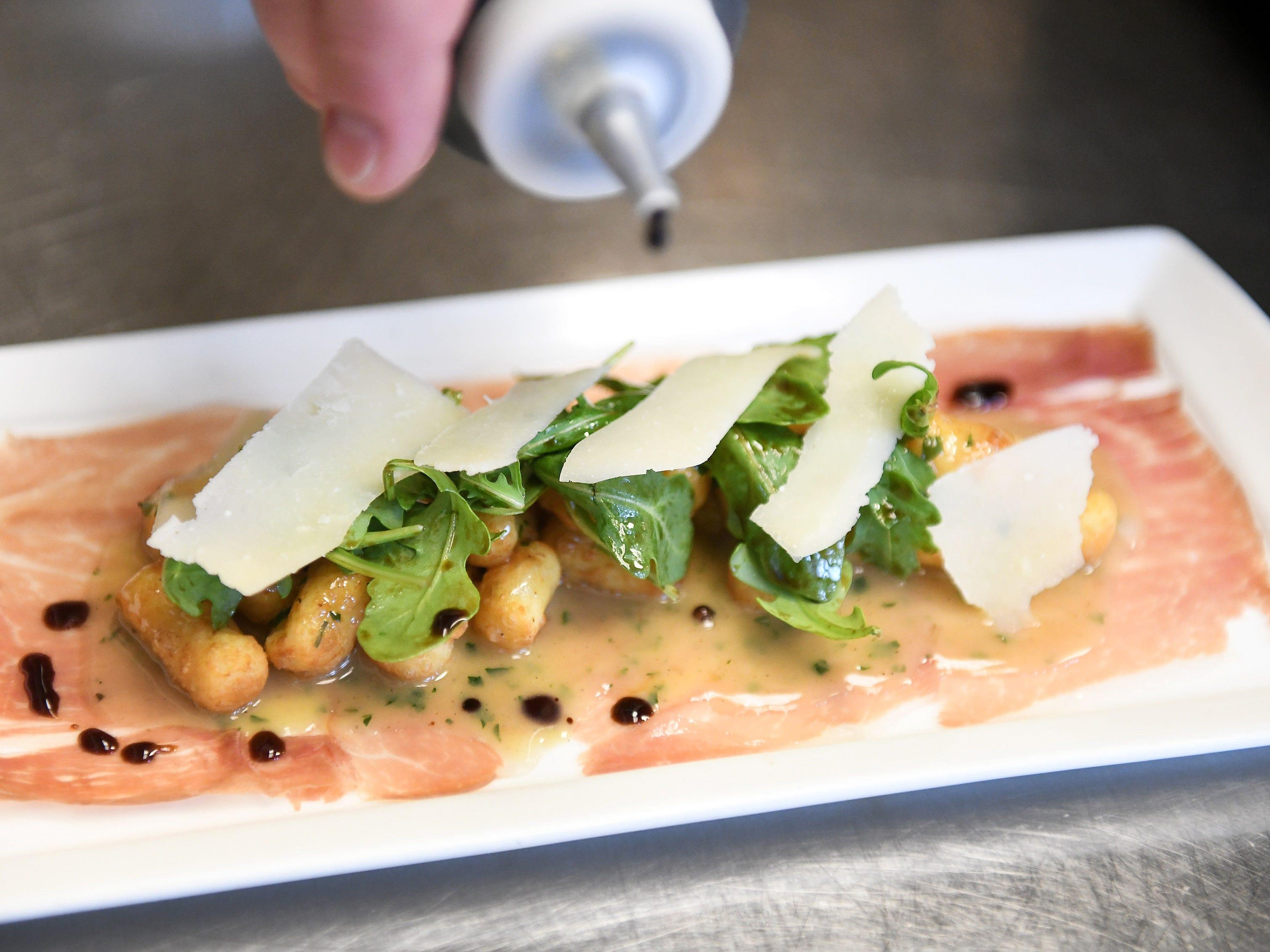 Parisian gnocchi with parma prosciutto, arugula, shaved Parmesan and saba.