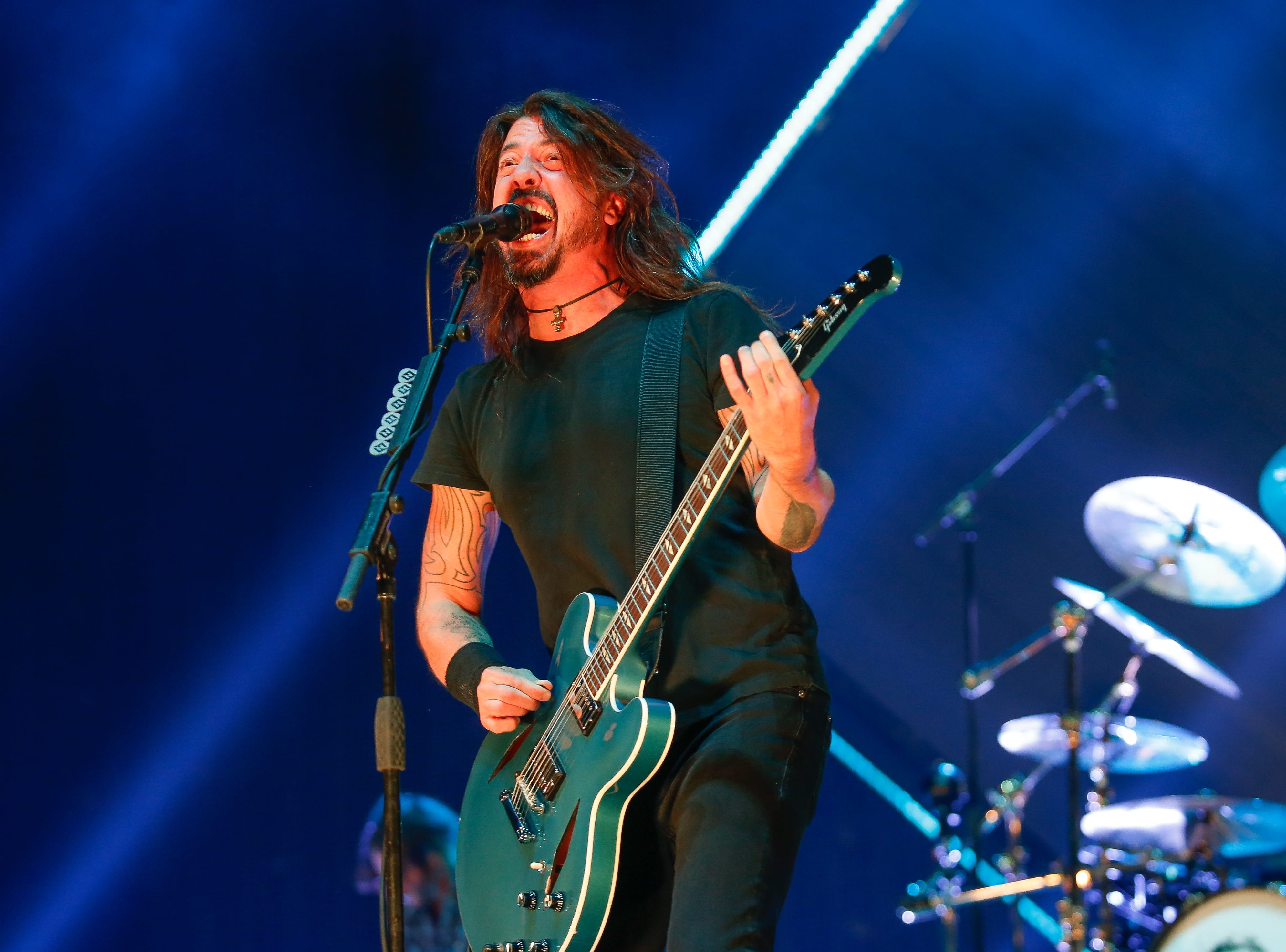 Foo Fighters lead singer and guitarist Dave Grohl sings at Monday's show at Little Caesars Arena.