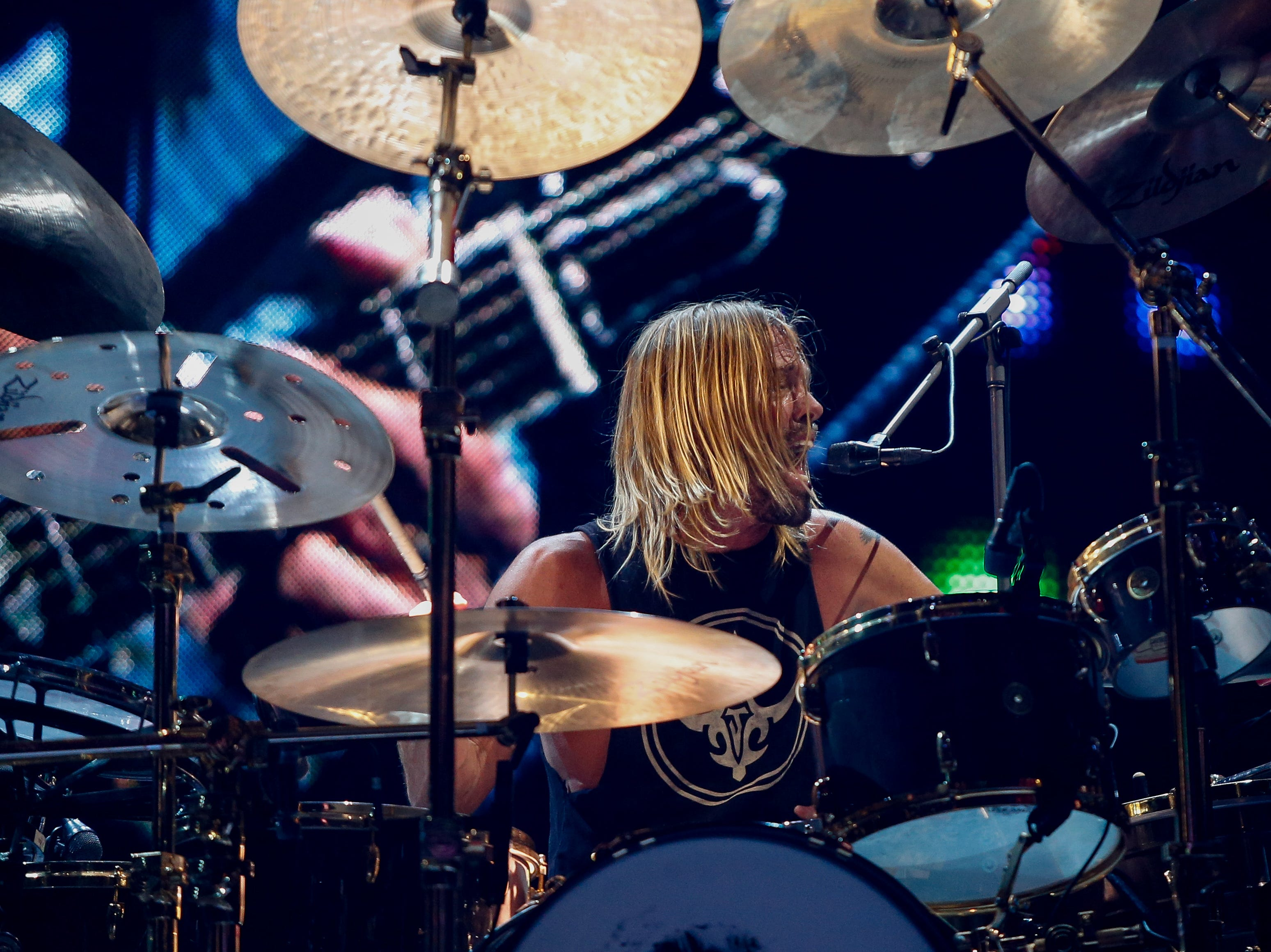 """Drummer Taylor Hawkins adds backing vocals to """"The Sky is a Neighborhood"""" at Monday's concert at Little Caesars Arena."""