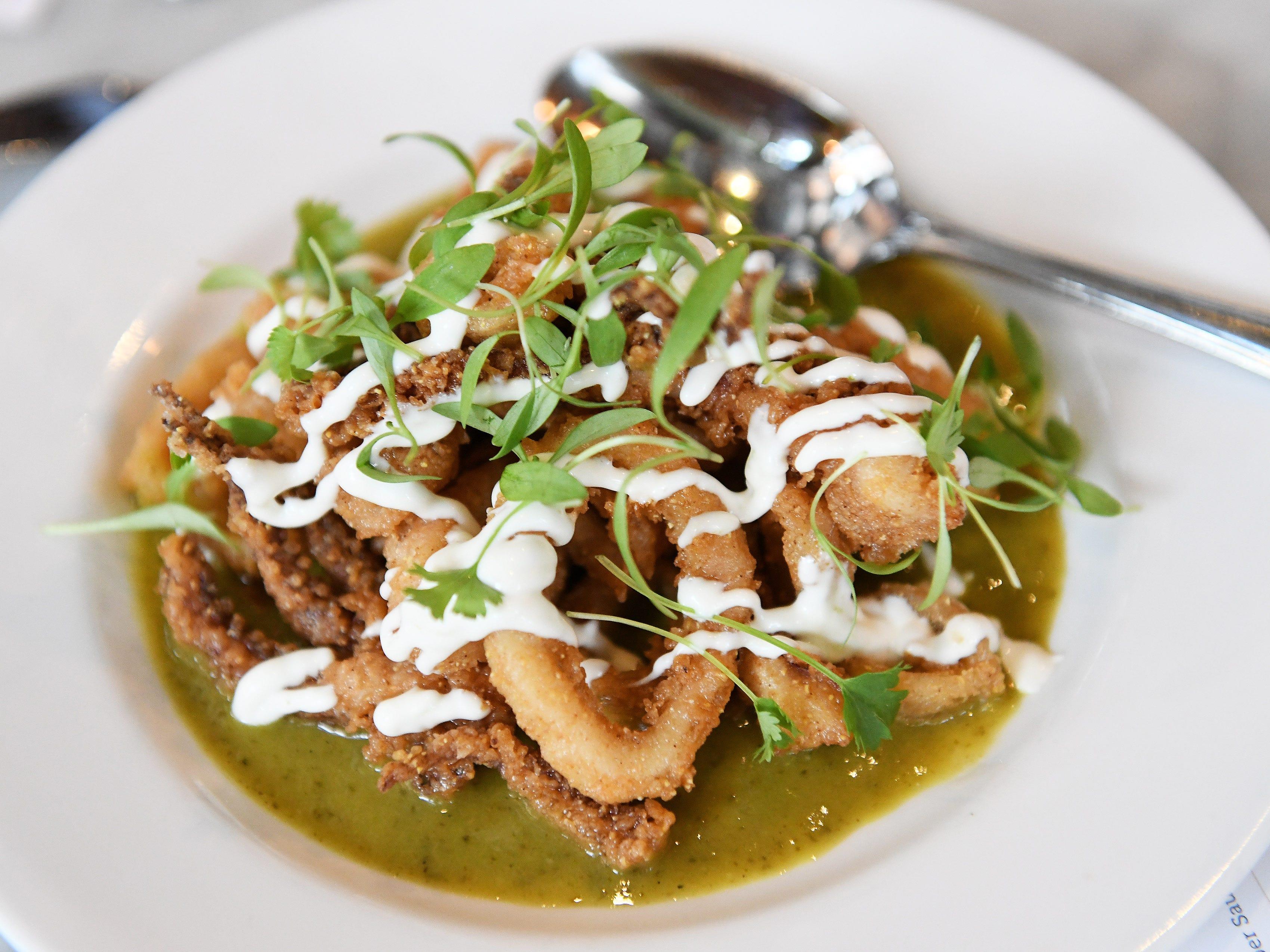 Crispy calamari cornmeal crust, poblano pepper sauce, lime crema and cilantro.