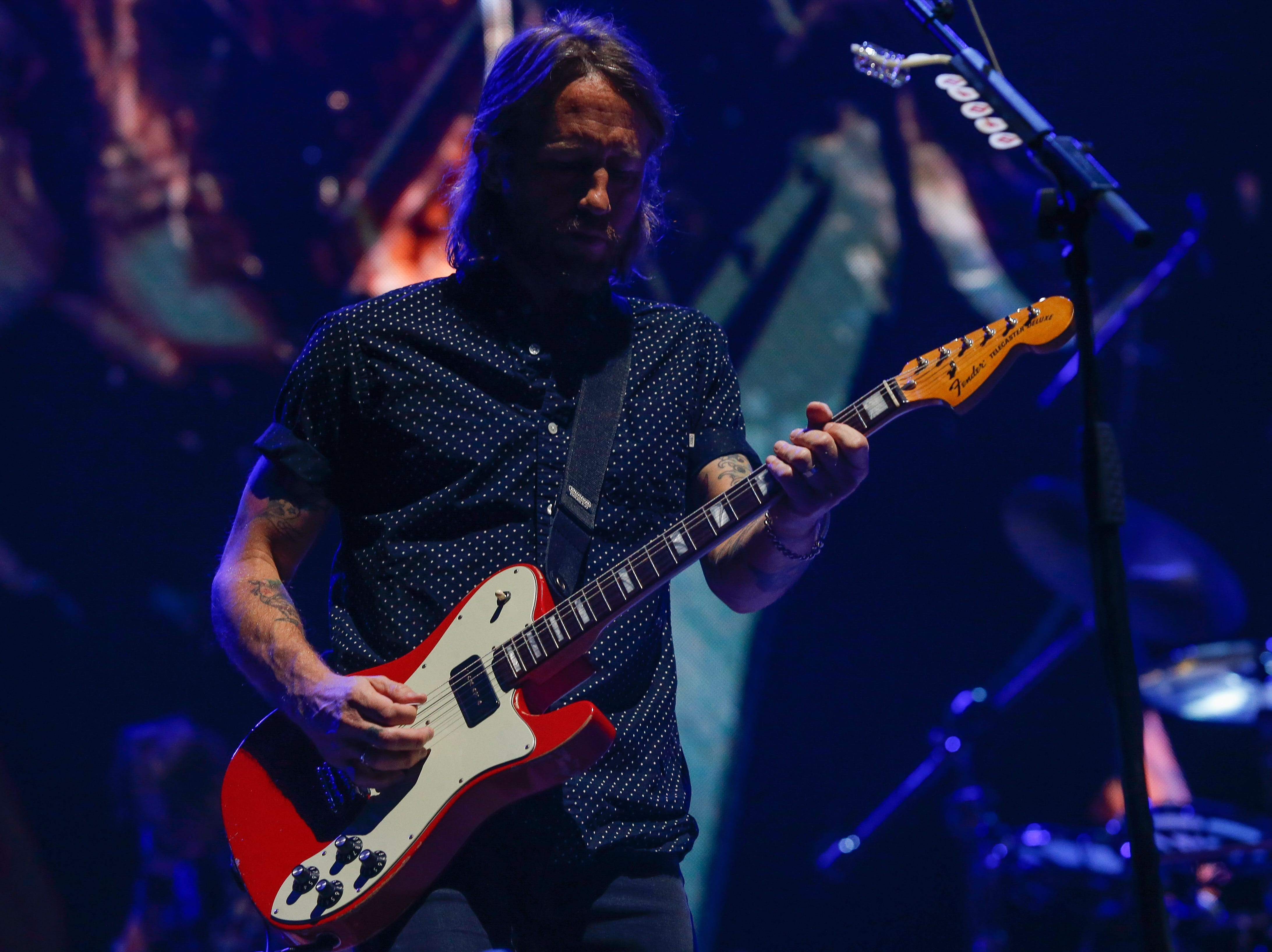 Chris Shiflett plays lead guitar for the Foo Fighters at Little Caesars Arena Monday night.