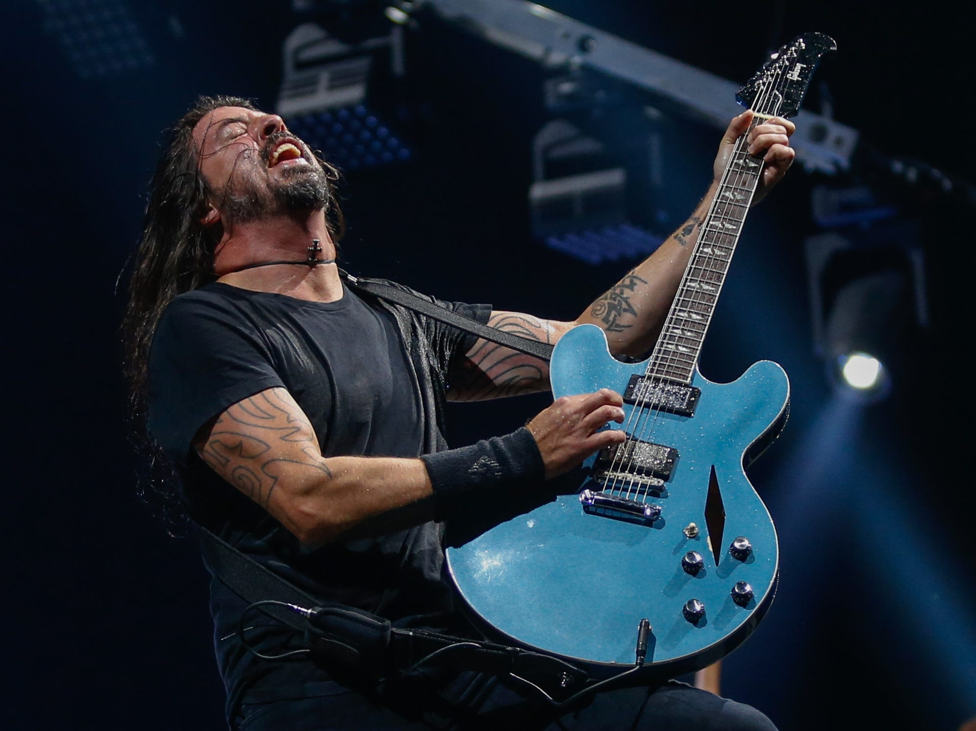 Foo Fighters lead singer and guitarist Dave Grohl performs at Monday's show at Little Caesars Arena.