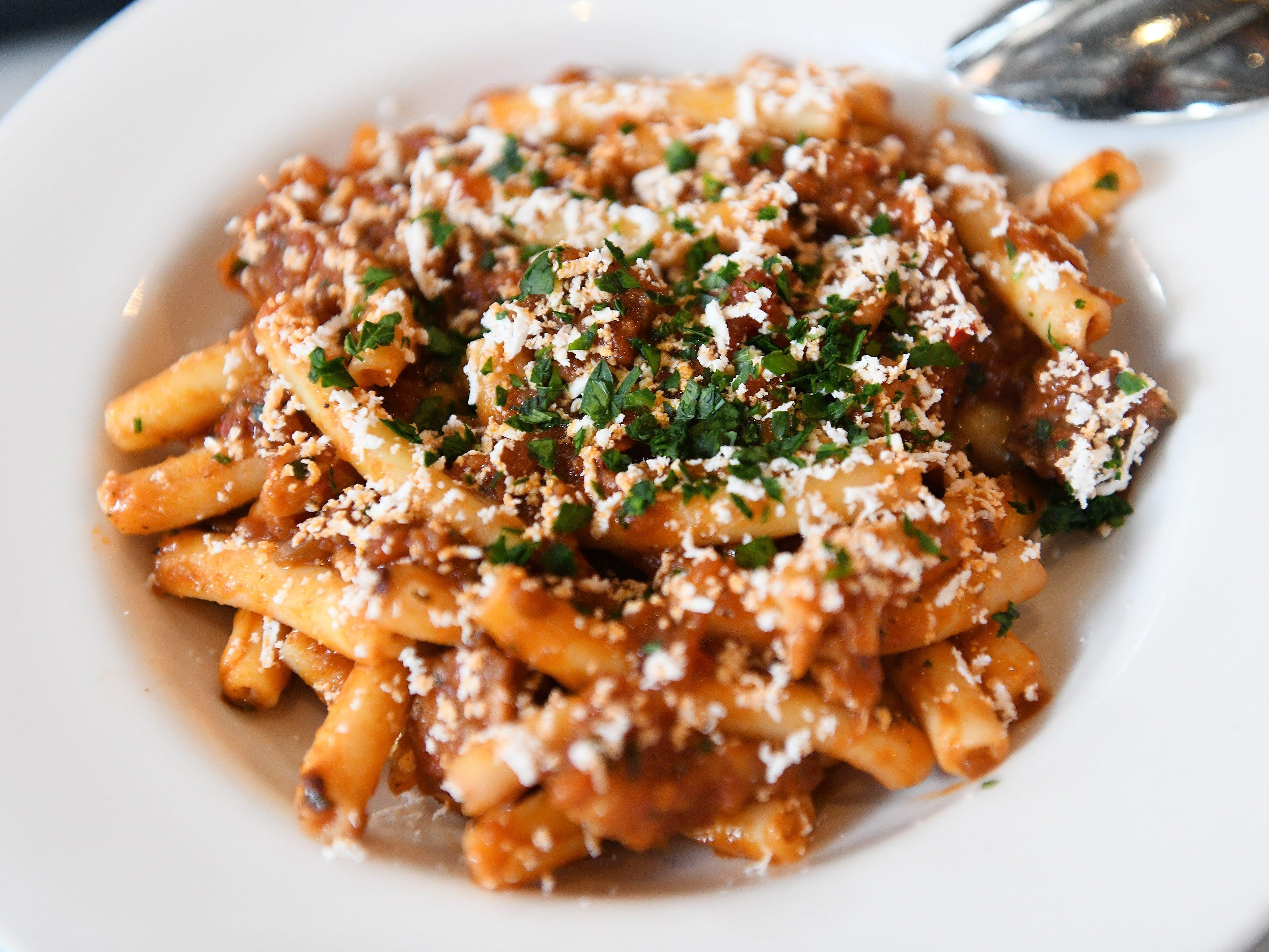 Spaccatelli pasta with pork sausage, braised chicken, smoked tomato sauce.