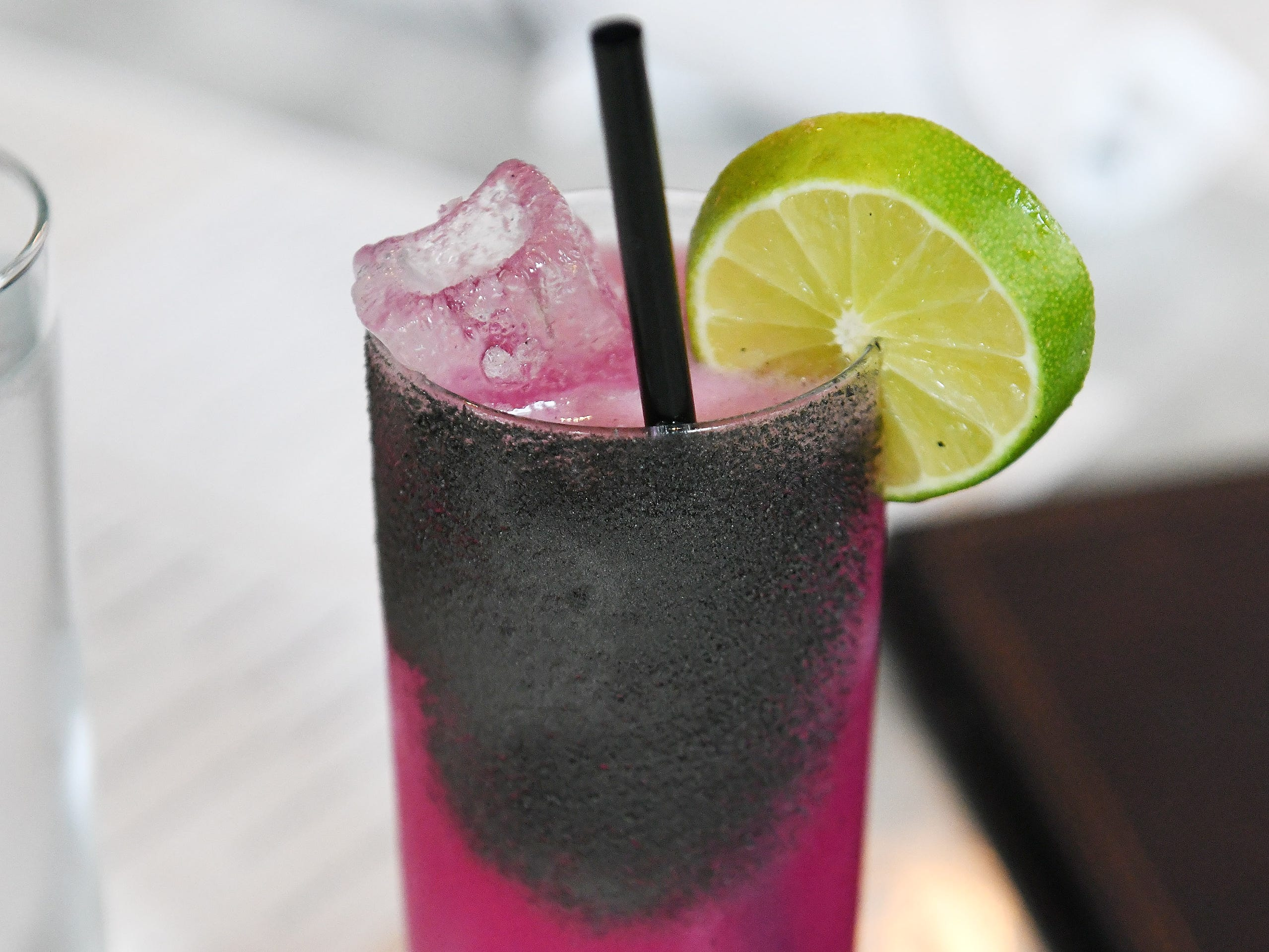A drink called Fire & Blood made with Patron Silver tequila, dragon fruit, lime, grapefruit, habanero and soda.