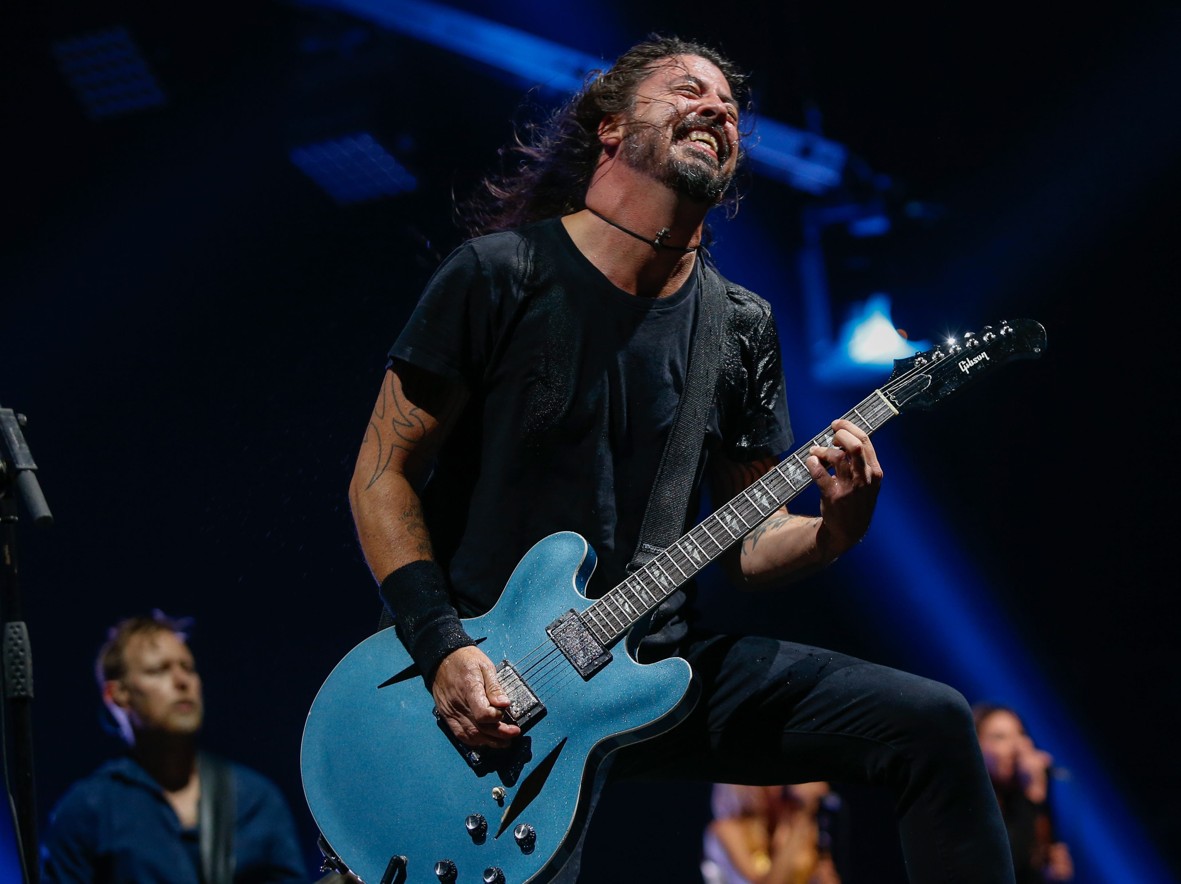 """Dave Grohl performs """"Run"""" from the Foo Fighters' current release """"Concrete and Gold"""" at Little Caesars Arena Monday."""