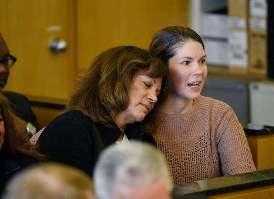Sharon McPhail, left, is comforted by her daughter, Erica, during a hearing Tuesday in Wayne County Circuit Court.