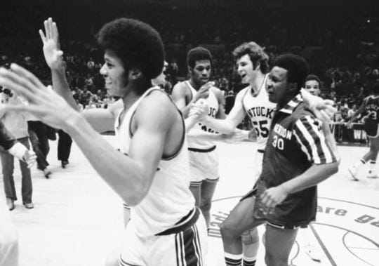 Dwane Casey, right, celebrates a win for Kentucky in 1976. Casey later served as an assistant and recruiter at Kentucky, before a recruiting scandal of which he later was acquitted.
