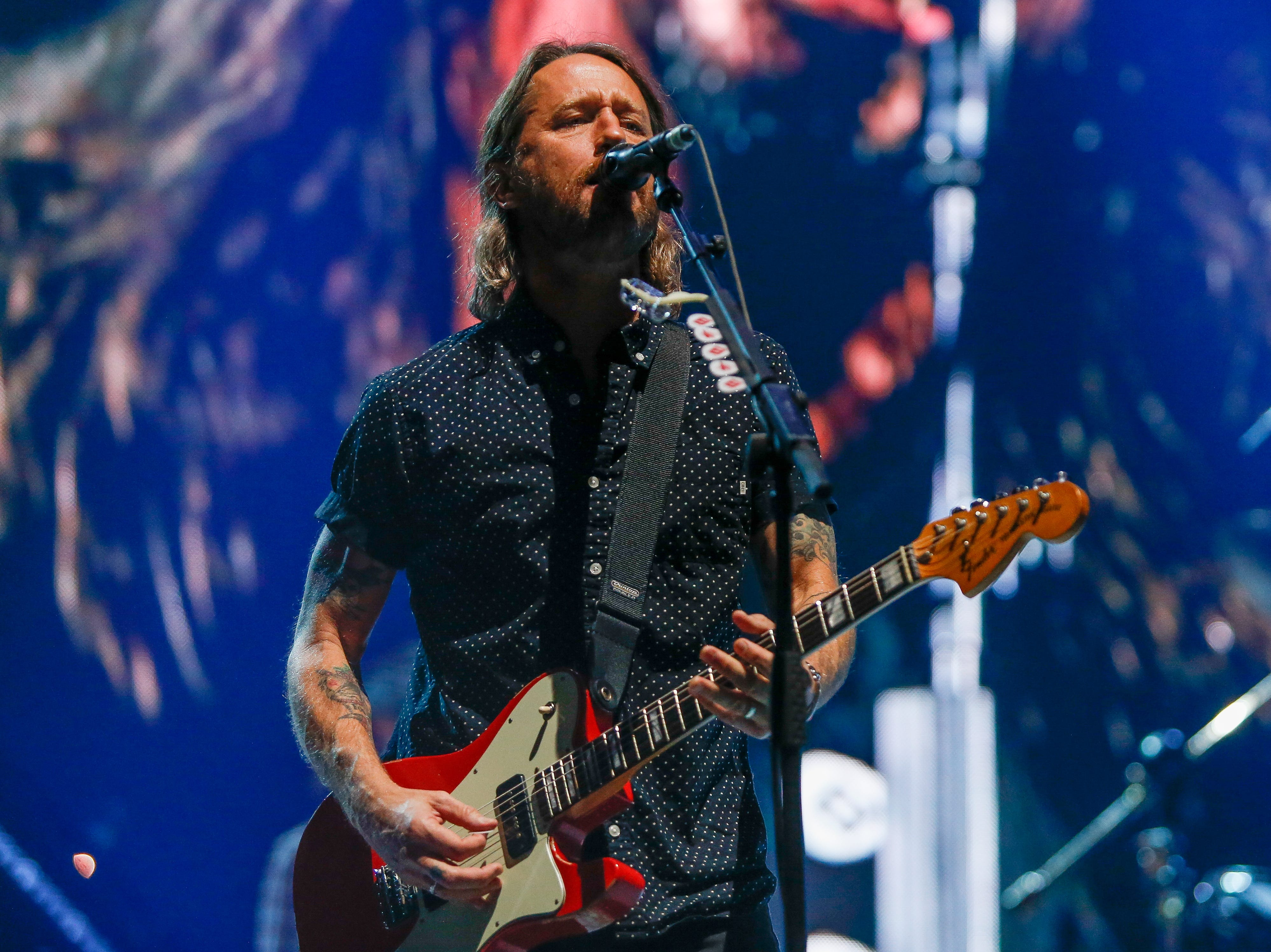 Chris Shiflett plays lead guitar and adds backing vocals.