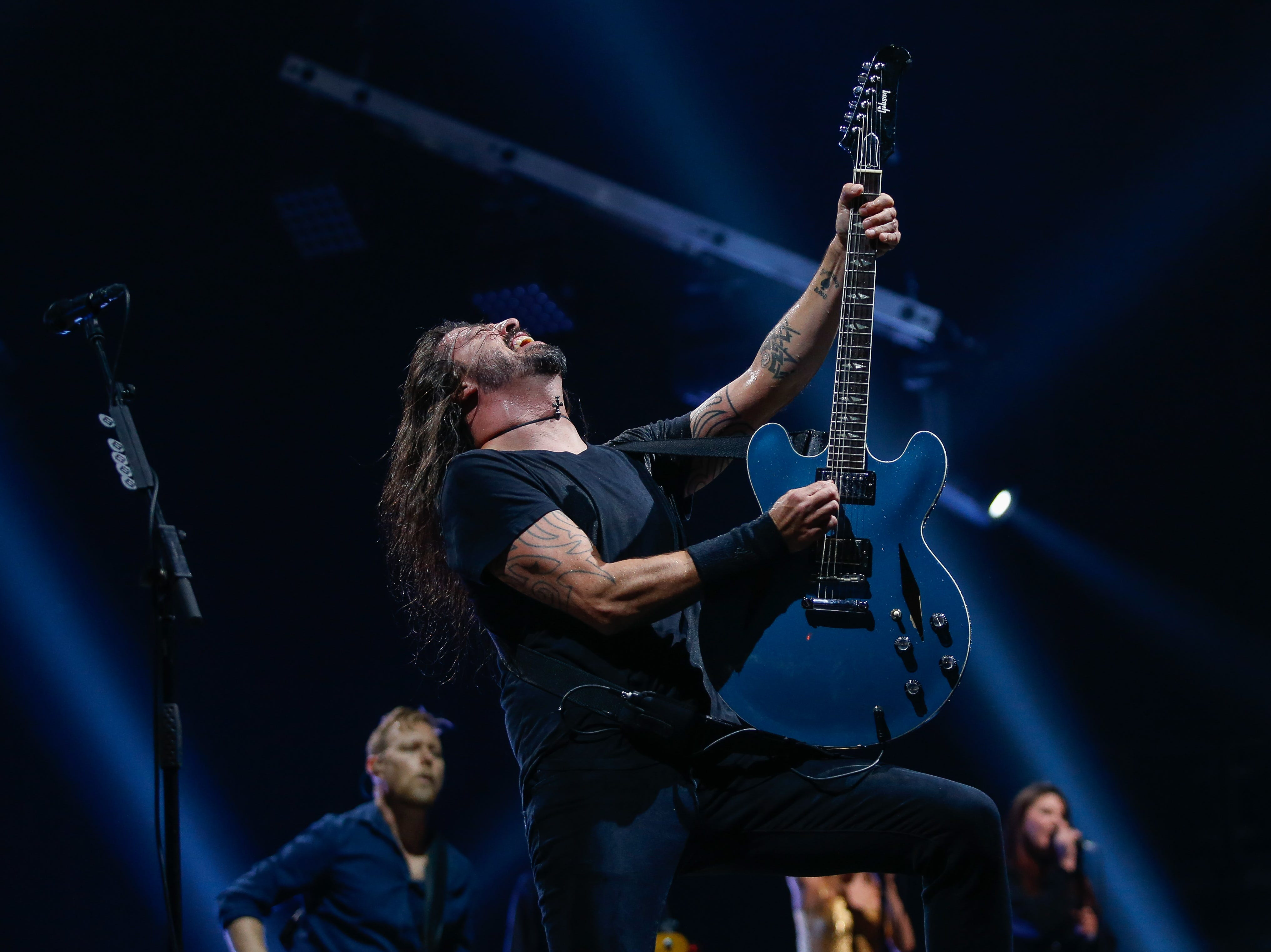 Dave Grohl (pictured) and the Foo Fighters performed for more than two hours for a packed Little Caesars Arena Monday night.