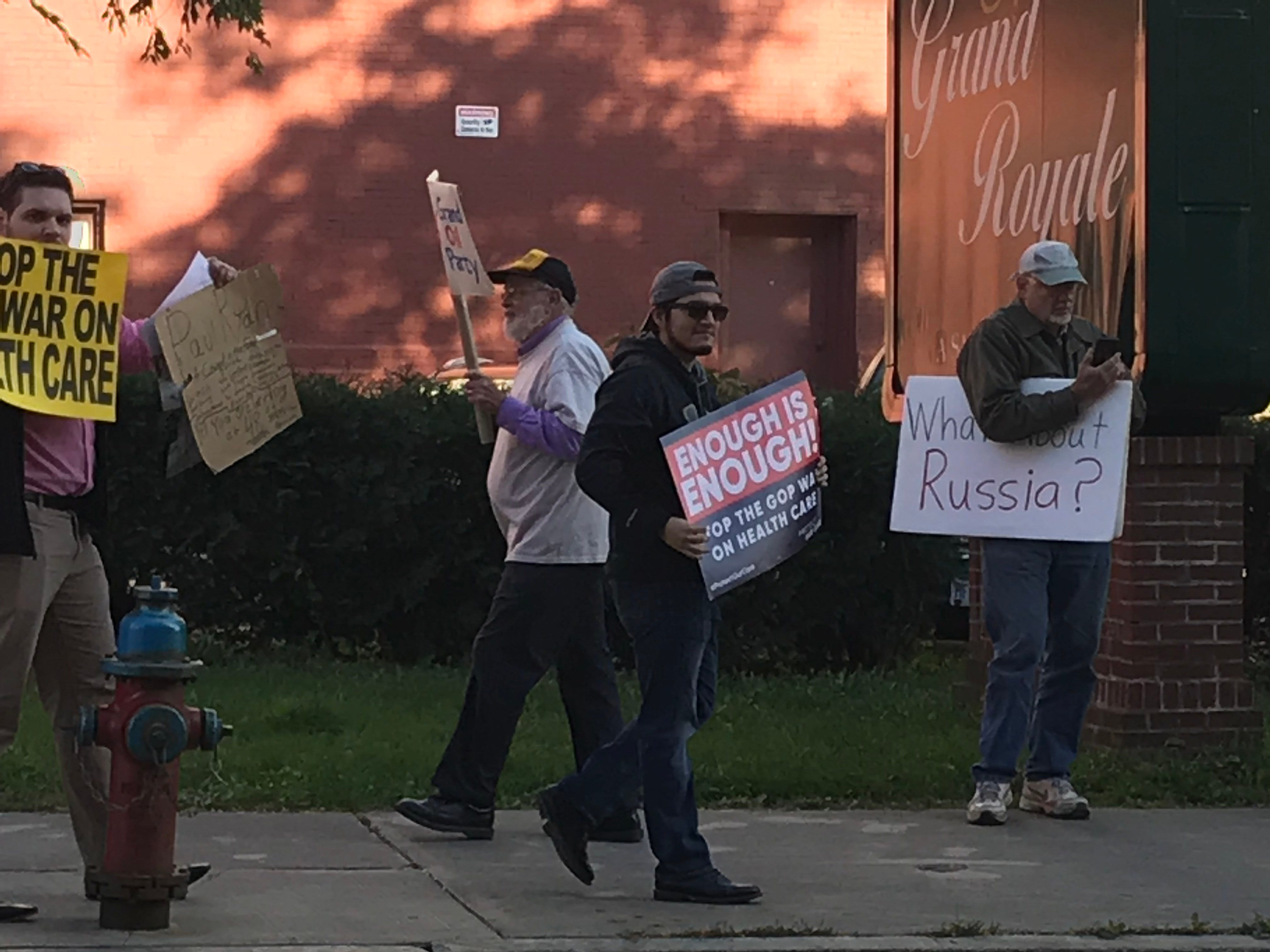 A group protests Paul Ryan and Claudia Tenney in Binghamotn