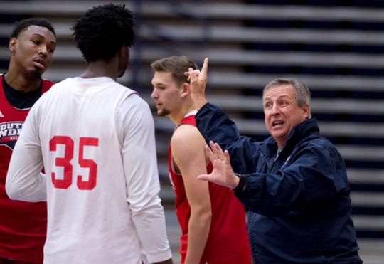 University of Southern Indiana's men's head basketball coach Rodney Watson instructs his team on defenseduring the first practice of the season at the Physical Activities Center at USI Monday afternoon. Watson will be coaching his ninth season at the school.