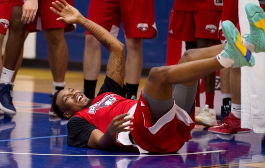 University of Southern Indiana's Josh Price takes a charge during a drill during the first practice of the season at the Physical Activities Center at USI Monday afternoon.