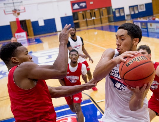 University of Southern Indiana's Mateo Rivera pulls down a rebound during the team's first official practice at the Physical Activities Center at USI Monday afternoon.