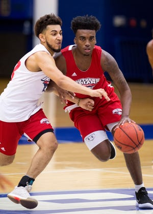 University of Southern Indiana's Kobe Caldwell drives against teammate Humaad Khan during the first practice of the season at the Physical Activities Center at USI Monday afternoon.
