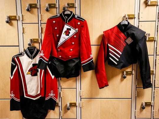 Past Fond du Lac High School band uniforms. Far left was from 1993 to 2001. The middle was from 2001 when the new high school was built to 2018, and the right was introduced Friday, October 12, 2018 during the Football game at Fruth Field against Stevens Point High School. Doug Raflik/USA TODAY NETWORK-Wisconsin