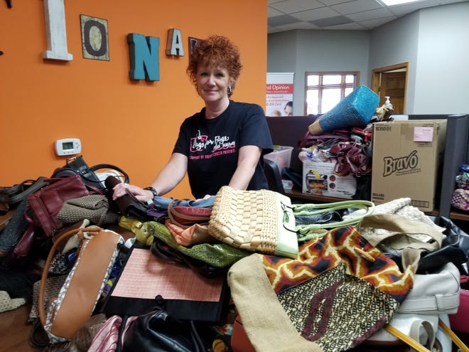 """Karen Jo Dobyns runs an event called """"Bags for Bags plus Scarves,"""" which sells used purses and scarves, with the proceeds going to Necessities Bag Wisconsin."""
