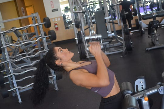 Hannah Gippert works out at Anytime Fitness in Fremont, where she is a personal trainer.