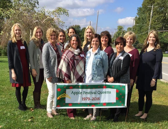 Former Oak Harbor Apple Festival Queens gather outside the home of Marilyn Sandwisch.  These women traveled from near and far to celebrate the 40th Apple Festival.