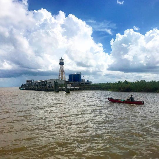 Erik Elsea, of Cape Coral, ends his 90-day canoe journey on Oct. 4 at  Port Eads - the mouth of the Mississippi River at South Pass, La. The steel lighthouse has stood for more than 120 years. Everything else was wiped out in Hurricane Katrina and rebuilt.
