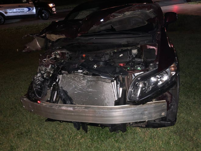 A drunken driver hit two parked unmarked Cape  Coral Police cars Sunday night.
