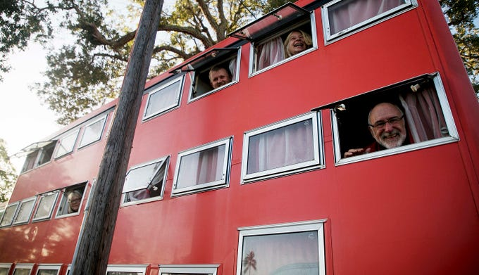 From right to left, Rotel Tours guests Fritz Loescher, tour guide, Birgit Zahn, guest, Siegi Volkner and guest Claudia Frehland poke their heads out their living quarters on the Rotel bus at the Red Coconut R.V. Resort on Fort Myers Beach on 10/16/2018. This tour started in New Jersey and is touring the eastern U.S. Rotel Tours are worldwide.