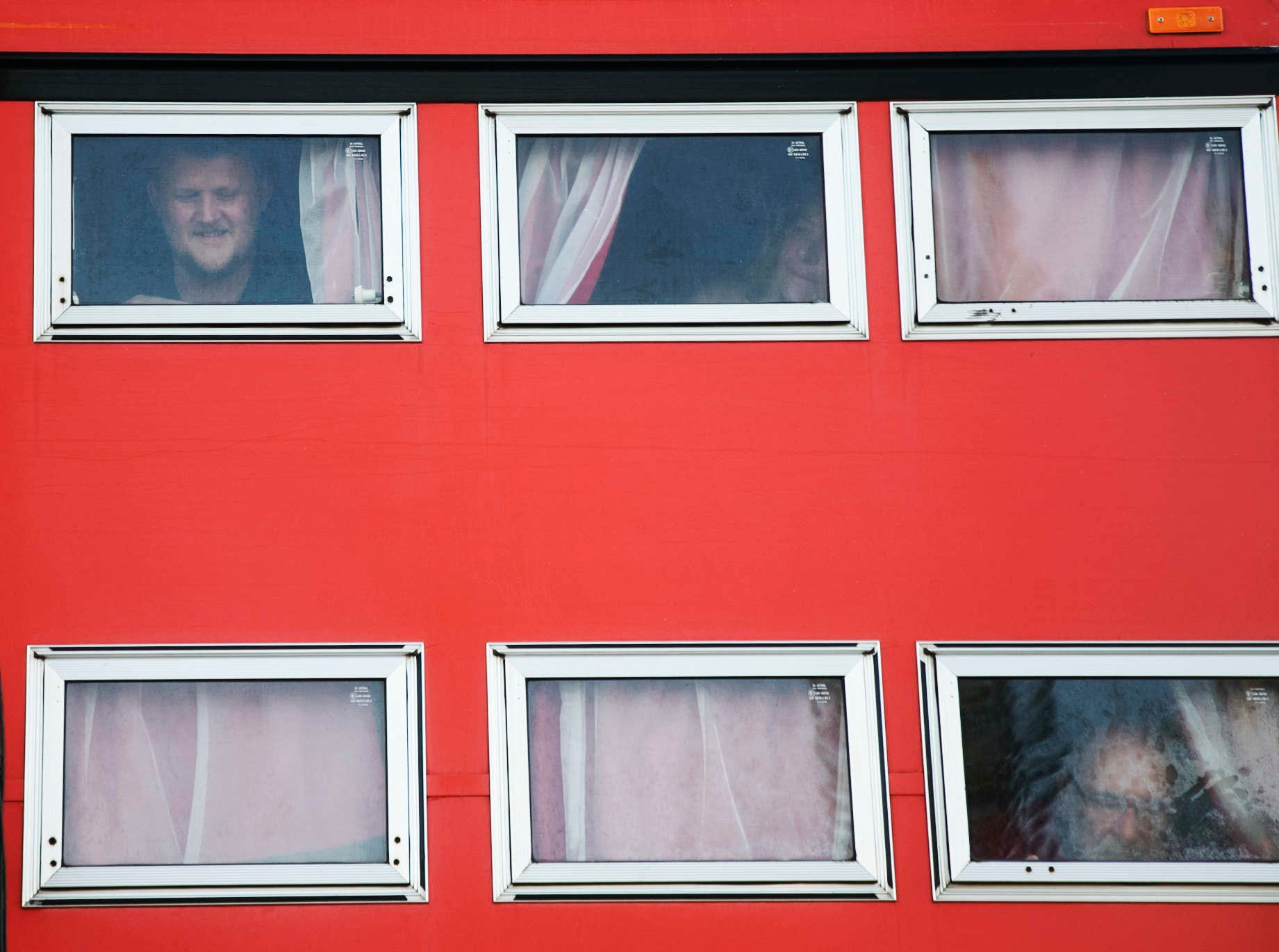 From right to left, Rotel Tours guests Fritz Loescher, tour guide, Birgit Zahn, guest, Siegi Volkner close thier windows after a portrait on the Rotel bus at the Red Coconut R.V. Resort on Fort Myers Beach on 10/16/2018. This tour started in New Jersey and is touring the eastern U.S. Rotel Tours are worldwide.