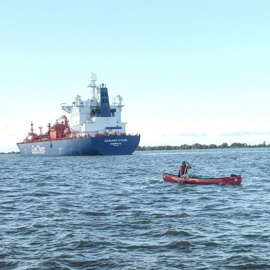 Erik Elsea paddles near a freighter on Day 89 in Venice, La. His 90-day journey down the MIssissippi River was about to end.