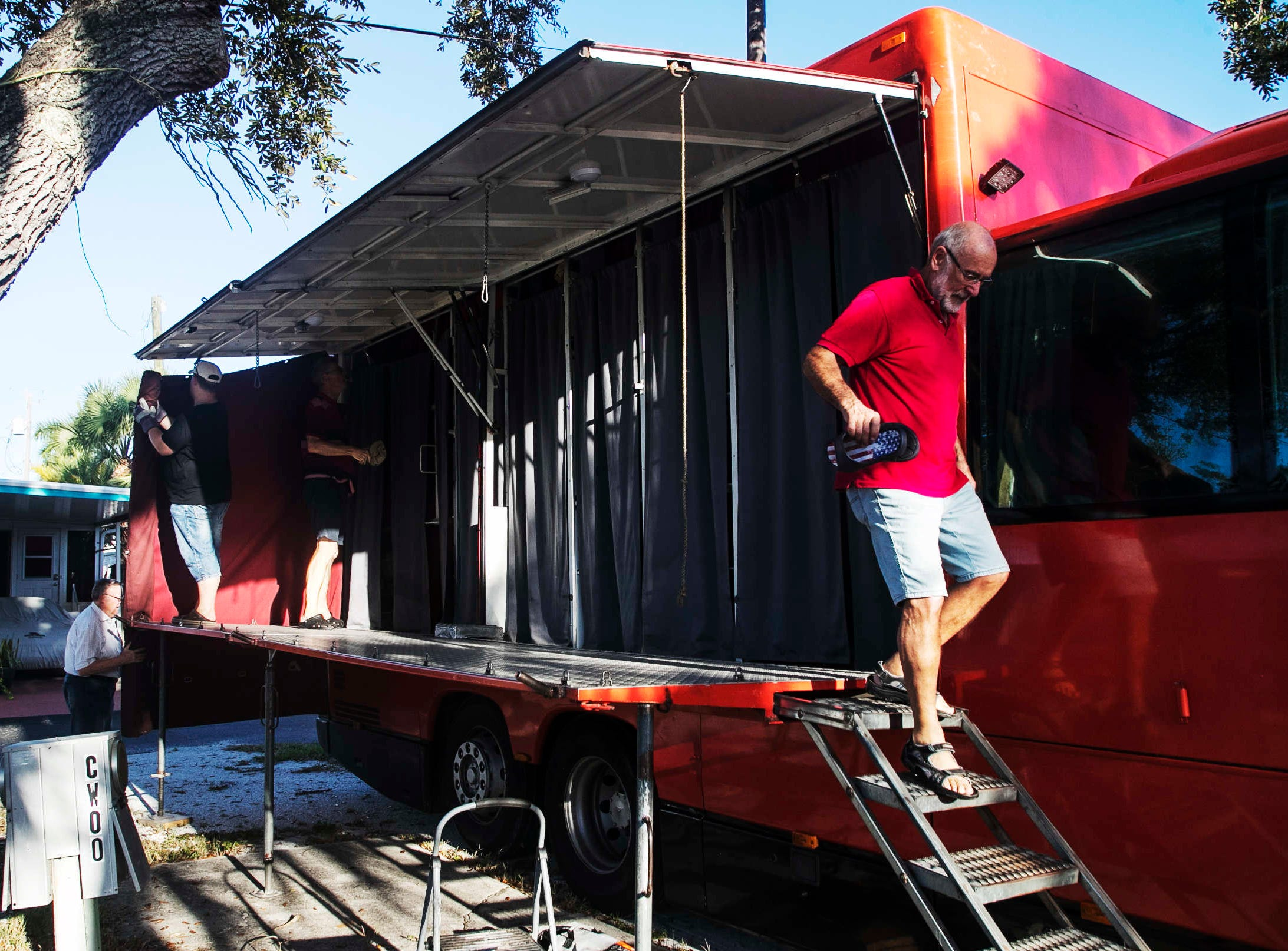 """Rotel Tours guest Fritz Loescher helps dissassemble the living quarters of the  on the Rotel bus, a """"rolling hotel"""" at the Red Coconut R.V. Resort on Fort Myers Beach on 10/16/2018. This tour started in New Jersey and is touring the eastern U.S. Rotel Tours are worldwide. The tour is visiting the area for a couple of days."""