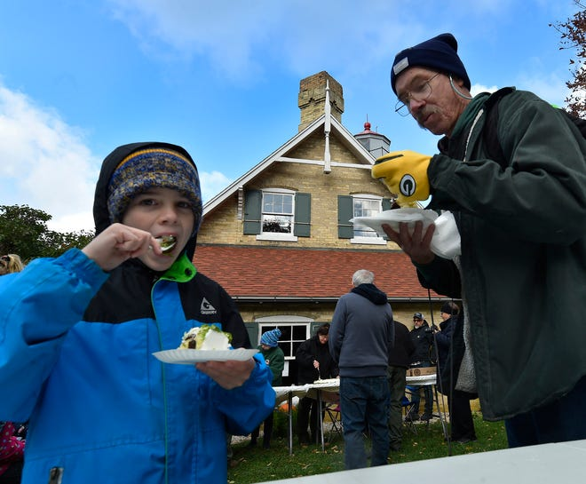 Damian Ray Pluff and his grandfather Terence Pluff, both of San Diego, attend the 150th anniversary celebration of the Eagle Bluff Lighthouse in Fish Creek on Monday, Oct. 15, 2018. Both are descendants of lightkeeper William Duclon who served 35 years from 1883 to 1918. More photos at www.doorcountyadvocate.com.