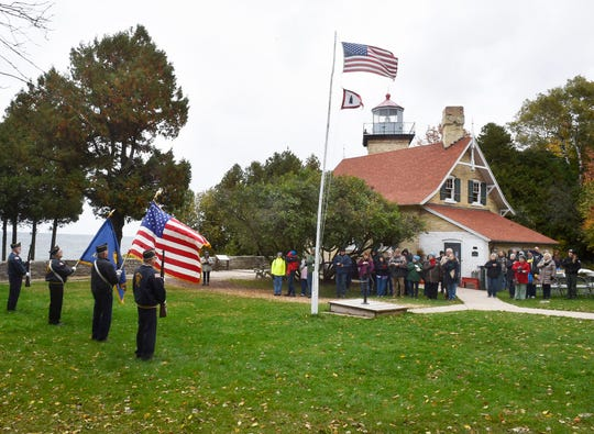 Sister Bay American Legion Post 527 provided a flag ceremony while the Gibraltar High School Marching Band performed the National Anthem at the start of the 150th anniversary celebration of the Eagle Bluff Lighthouse in Fish Creek on Monday, Oct. 15, 2018. The tower light — fueled by lard — was first lit Oct. 15, 1868. More photos at www.doorcountyadvocate.com.