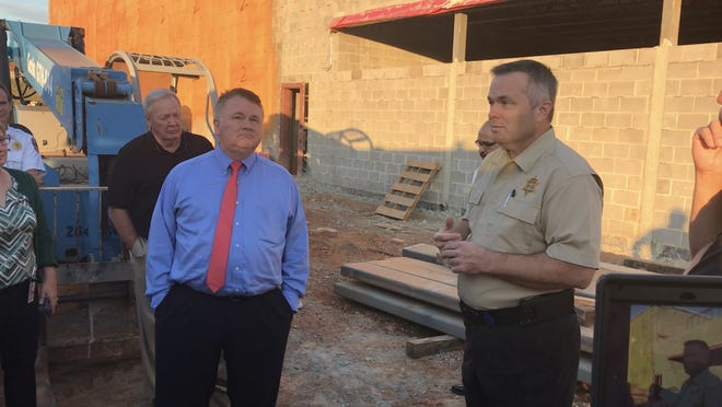 Pickens County Sheriff Rick Clark, right, gives members of County Council a tour of the new jail under construction.