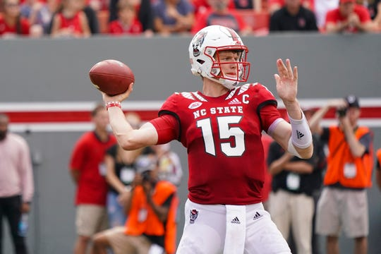 Oct 6, 2018; Raleigh, NC, USA;  North Carolina State Wolfpack quarterback Ryan Finley (15) throws the ball during the second half against Boston College Eagles at Carter-Finley Stadium. The North Carolina State Wolfpack defeated the Boston College Eagles 28-23. Mandatory Credit: James Guillory-USA TODAY Sports